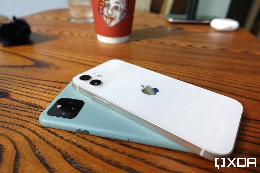 Google Pixel 5 Blue and Apple iPhone 12 White placed on a table