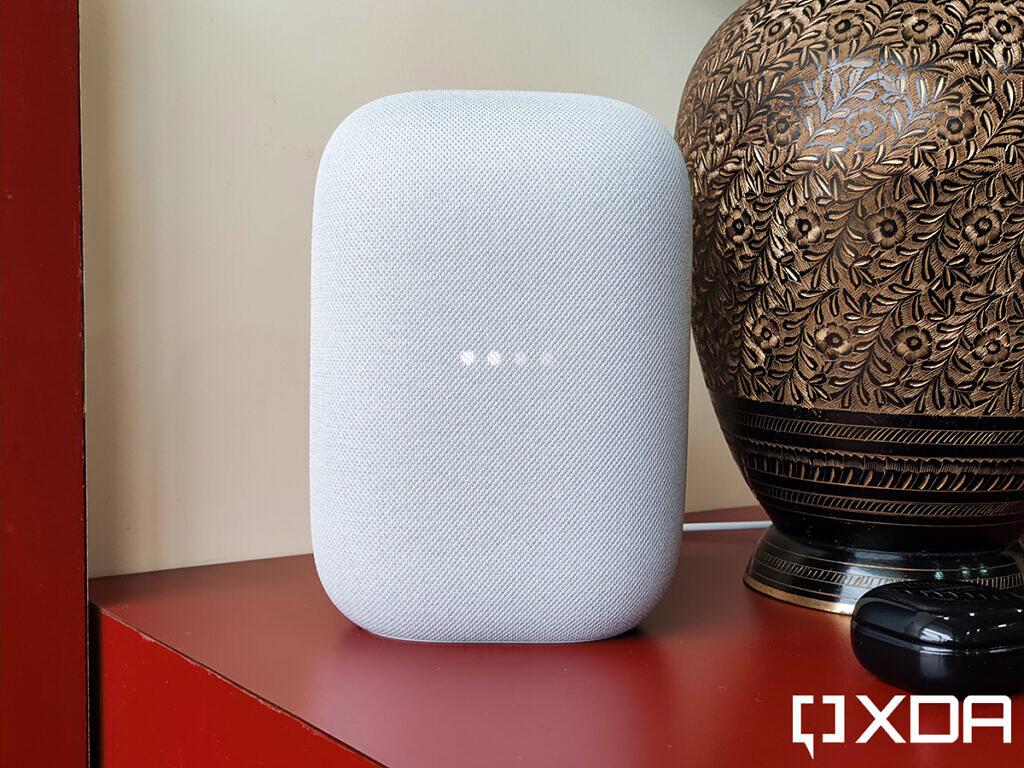 Google-Nest-Audio-XDA-Chalk-on-red-table-besides-flower-vase