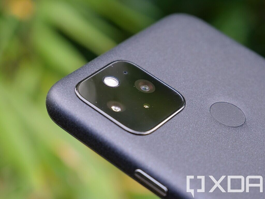 Google Pixel 5 close up of camera with plants in the background